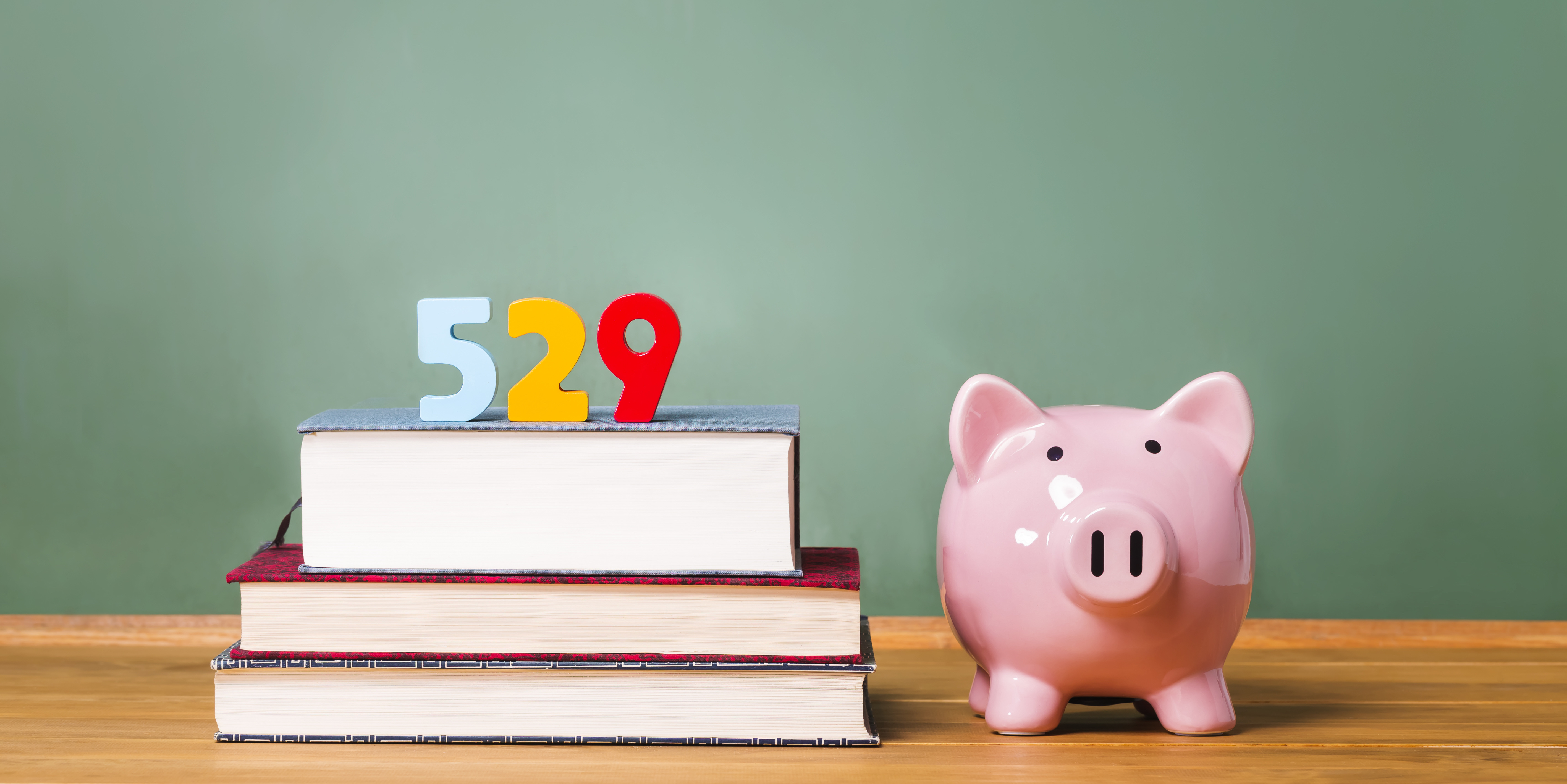 Piggy bank and stack of school books
